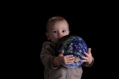 Boy child holding world. 'Please protect my world'. Boy holding world on isolated black stock images