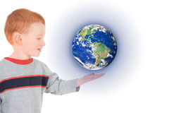 Boy child holding world on hand. Boy holding world suspended above hand. Isolated on white Stock Images
