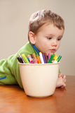 Boy child with kids colored drawing pens. Boy with colored pens on table Royalty Free Stock Image