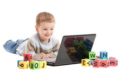 Boy child learning education on computer notebook. Boy child learning on laptop computer. Isolated on white Stock Image