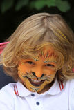 A boy child painted as a lion Stock Photos