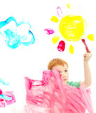 Boy child painting art picture on window royalty free stock photography