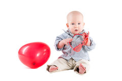 Boy child is in a plaid shirt, a red balloon Royalty Free Stock Photography