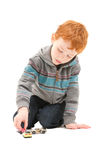 Boy child playing with kids toy cars. Boy child playing with toy cars. On white Royalty Free Stock Photos