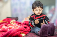 Boy child playing with mobile phone Stock Photography