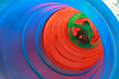 Boy child playing in tube Royalty Free Stock Images