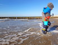 Boy child playing in the waves on Baltic Sea stock photos