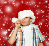 Boy child portrait on red, winter holiday concept royalty free stock photography