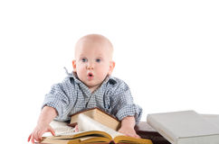 Boy child is reading books Stock Images