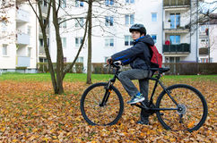 Boy child riding a bicycle Stock Images