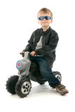 Boy on child's motorcycle Stock Photo