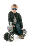 Boy on child's motorcycle Royalty Free Stock Photos