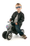 Boy on child's motorcycle Stock Images