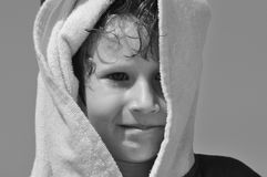 The boy, a child in a towel and hood on the beach. Stock Photography