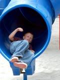 Boy Child In Tube Slide royalty free stock photo