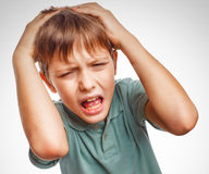Boy child upset angry shout produces isolated evil Royalty Free Stock Photo