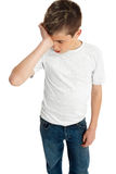 Boy child upset,  stressed or tired. A pre teen boy rubbing eyes, tired, stressed, sadness, depression Stock Photos