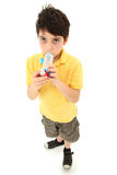 Boy Child Using Asthma Inhaler with Spacer Chamber Stock Image