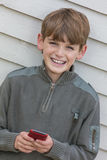 Boy Child Using Mobile Cell Phone Royalty Free Stock Photos