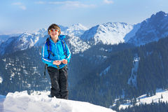 Boy child winter mountain top climbing Stock Photos