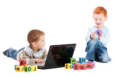 Boy children class with computer and kids alphabet. Boys with computer and blocks. Isolated on white Stock Photography