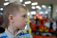 Boy in the children's amusement arcade.  Royalty Free Stock Images