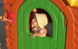 A boy in a children's house stock photo