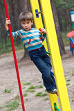 The boy on a children's playground Stock Images