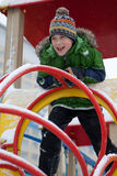 The boy on a children's playground. In the winter Stock Photo