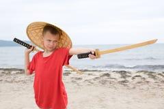Boy with children samurai swords Stock Photography