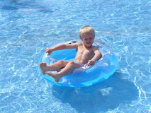 Boy chilling in the pool in talacre North Wales Royalty Free Stock Photo