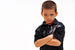 Boy, chin lowered, serious with arms crossed Stock Images