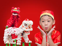 Boy with Chinese traditional dress exciting. Asian boy with Chinese traditional dress exciting with Chinese lion dancing,Chinese New Year con cept Royalty Free Stock Photo