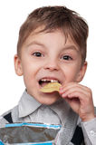 Boy with a chips Stock Images