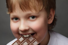 Boy with chocolate royalty free stock photography