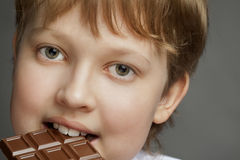 Boy with chocolate bar Royalty Free Stock Image