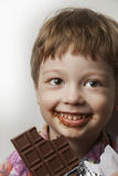 Boy with chocolate bar Royalty Free Stock Images
