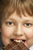 Boy with chocolate bar Stock Image