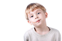 Boy with chocolate on the face  isolated Stock Photos