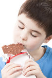 Boy with chocolate in the hands. On white Stock Photo