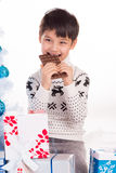 Boy and chocolate Stock Photos