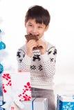 Boy and chocolate Stock Photos