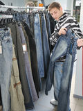 Boy choice jeans in shop. Boy choice jeans in wear shop Royalty Free Stock Photos