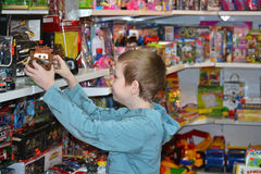 The boy chooses a toy in toy store. Stock Photography