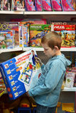 The boy chooses a toy in toy store. Stock Photo