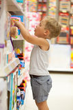 Boy choosing toy in the shop Royalty Free Stock Image