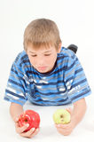 Boy chosing an apple Stock Images