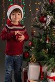 Boy with a Christmas ball Stock Photos
