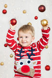 Boy with christmas balls Royalty Free Stock Images