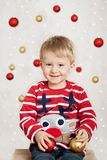 Boy with christmas balls Royalty Free Stock Photo